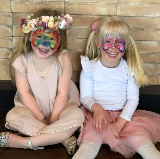 Two little girls with faces painted