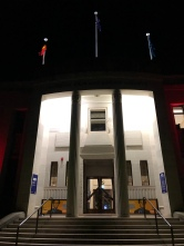 Exterior of National Film and Sound Archive building at night