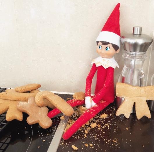 Elf on a shelf eating cookies