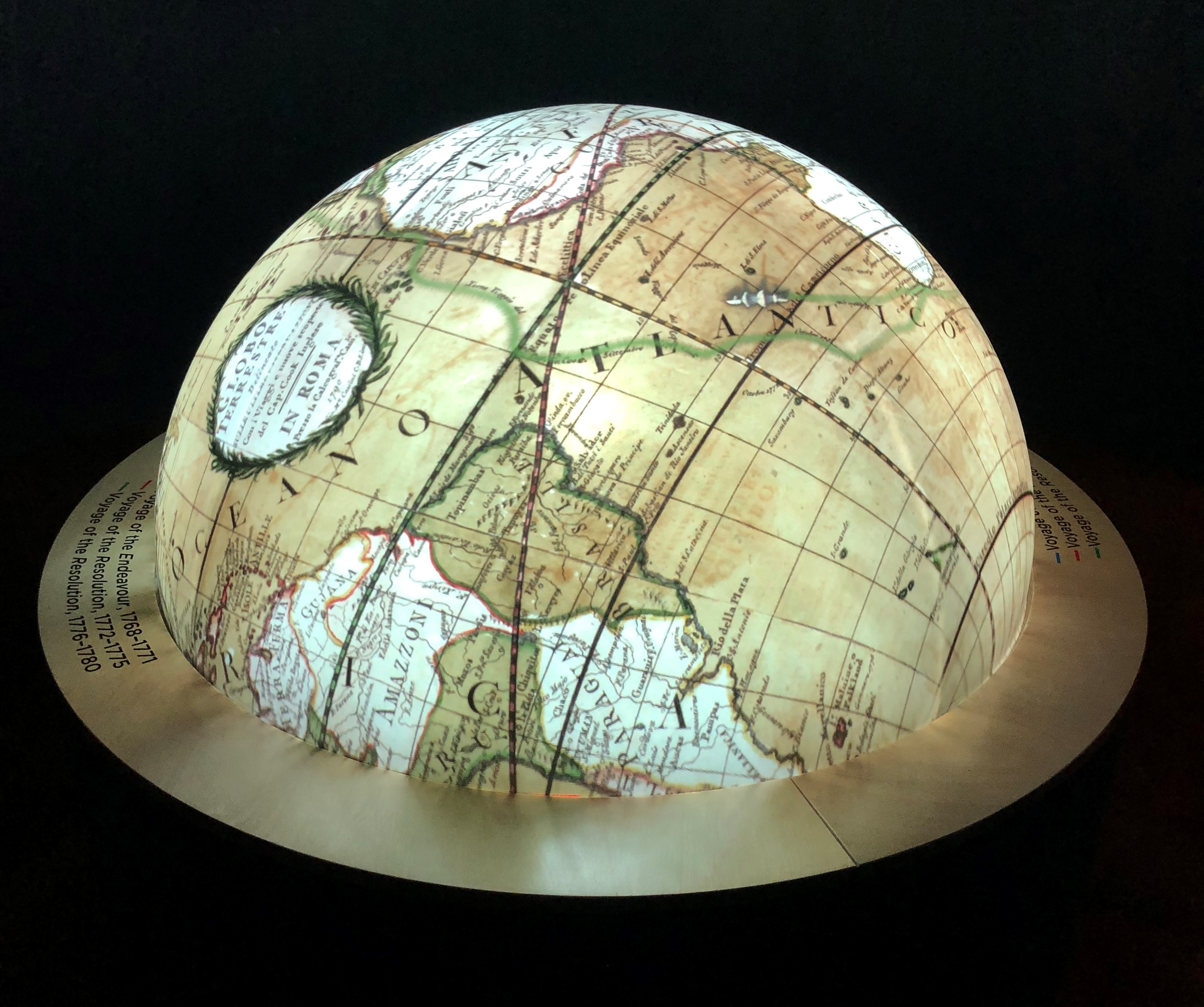 Illuminated globe depicting the travels of Captain James Cook from the Cook and the Pacific exhibition at the National Library of Australia